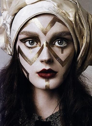 Gold design on face. En Garde! High Fashion Features Avant Garde Makeup | Lovelyish