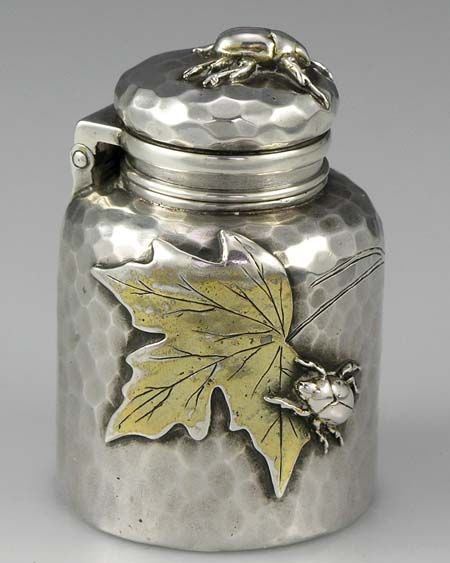 Without a doubt...a beautiful inkwell... Tiffany, mixed metal, applied aesthetic traveling inkwell...lovely