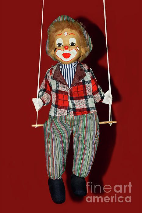 A cute little clown on a swing. Just love his painted face and striped / checkered clothing against a rich red background. Clown on Swing by Kaye Menner Photography Quality Prints Cards Products at: https://kaye-menner.pixels.com/featured/clown-on-swing-by-kaye-menner-kaye-menner.html