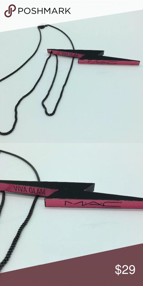 """MAC Cosmetics Miley Cyrus Viva Glam Necklace RARE MUST for a MAC Collector! MAC Viva Glam Miley Lighting Necklace Brand new never been worn. Brand New . You will not find this at any store location it was exclusive to employees. W/ black chain this lightning bolt shaped black and pink pendant is nearly 6"""" inches in length. This necklace was released in the Spring of 2015 in correlation with the Miley Cyrus VIVA GLAM hot pink lipstick and gloss release. Exclusive to M•A•C staff only, this…"""