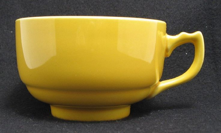 "Yellow cup from the Riviera line made by Homer Laughlin. This cup measures 3 3/4"" dia x 2 3/8"" tall..  Homer Laughlin made the Century shaped Riviera line from 1938 to 1948."