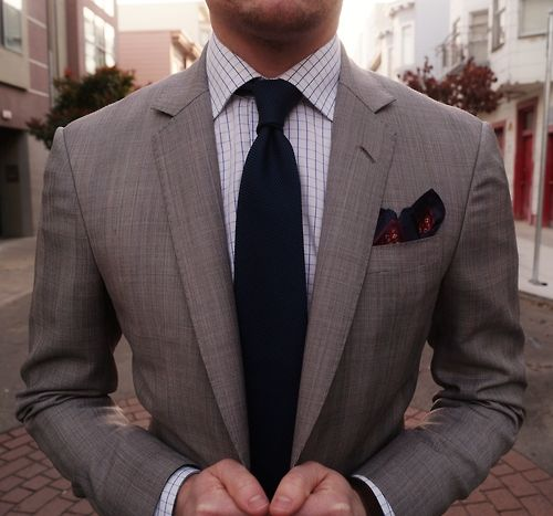Solid tie on checks, framed in grey