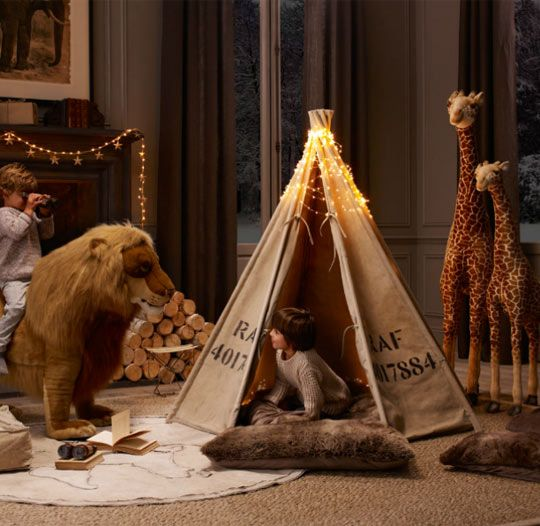 i want to recreate this- canvas tent, faux fur sleeping bag, giant stuffed animals- how fun is this??