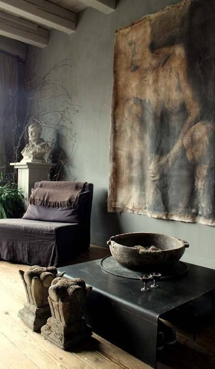 Vintage living room with hanging textile and old decor elements
