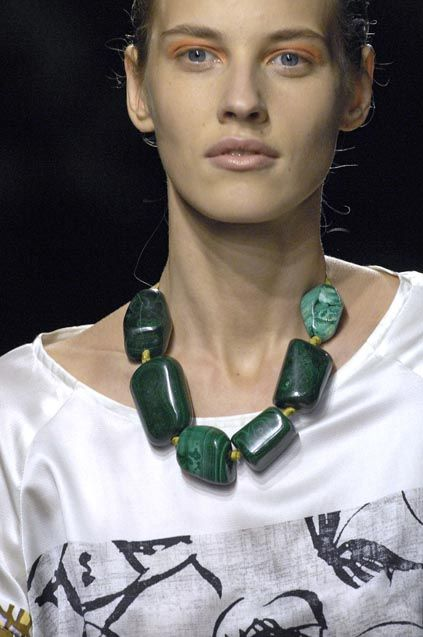 Dries Van Noten single strand Large Green Statement necklace stands out on white satin