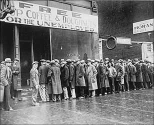 Depression era bread line.  Sign states FREE CUP COFFEE & DOUGHNUT FOR THE UNEMPLOYED.