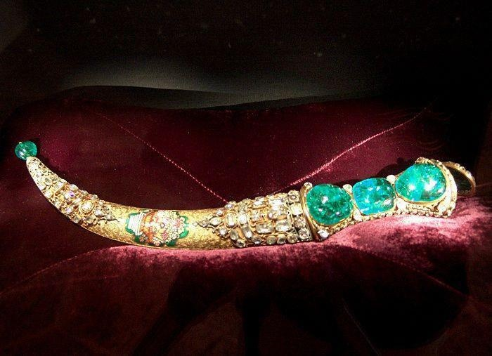 The Topkapi Emerald Dagger is the jewel-studded dagger of mid-18th century origin. One side of the handle of the dagger is set with three large Colombian emeralds . The dagger was actually one of several other valuable gifts that was carried by an embassy of Sultan Mahmud I (1730-54) to Iran, to be gifted to the Iranian conqueror Nadir Shah, but was not delivered as Nadir Shah was assassinated, The gifts including the jewel-studded dagger were then returned to the treasury at Istanbul.