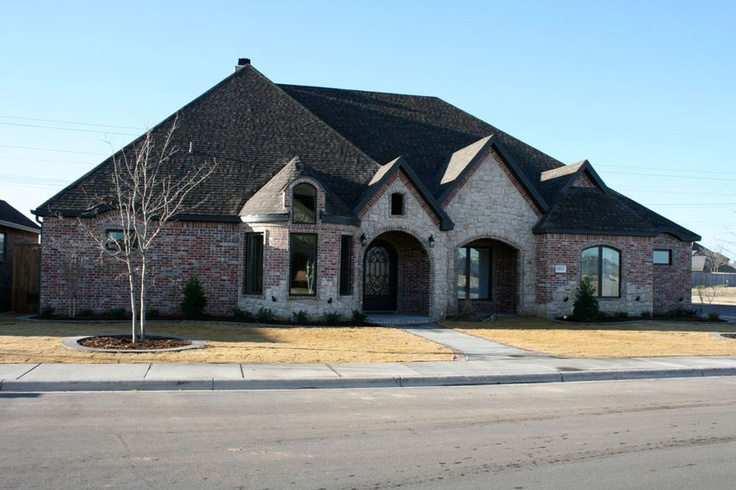 Exterior trey strong custom homes this is the color of for Mixing brick and stone