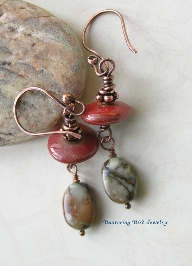 Bantering Bird:  Long Dangle Earrings Earthy Patterned Stone Rhyolite Red Elaine Ray Ceramic Disks Southwestern Copper. $24.00, via Etsy.