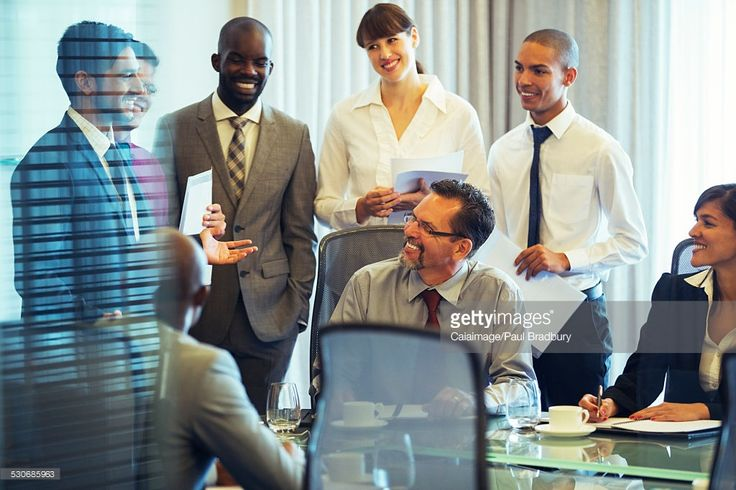 Stock Photo : Business people smiling in conference room during business meeting