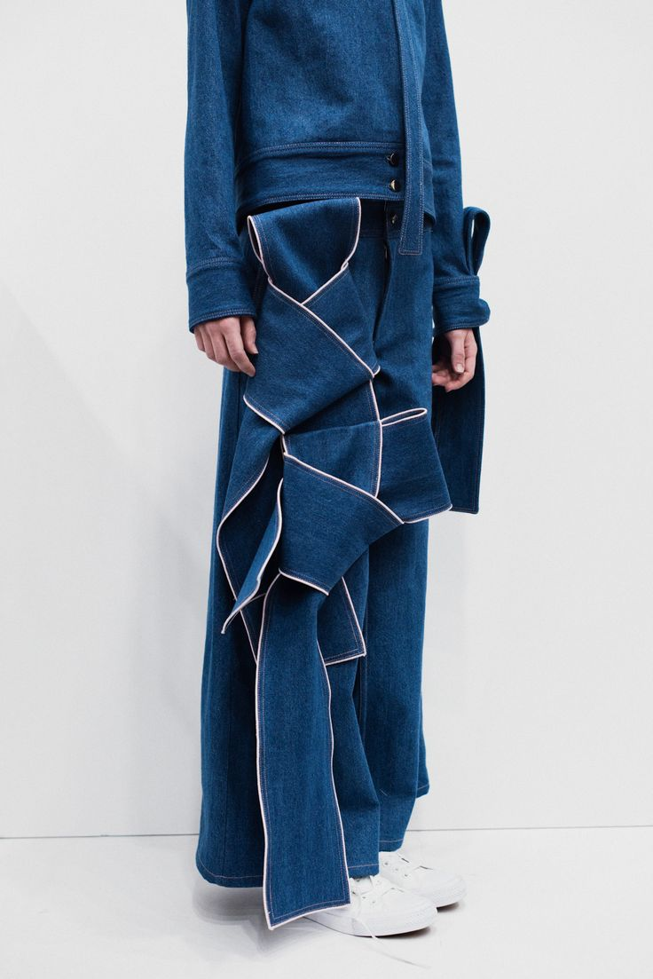 She's become a master at sculptural draping and yet, she's only two seasons into her eponymouslabel. Designer Claudia Li, a formerwomenswear designer at J.W. Anderson, pursued the theme of self preservation for her latest collection. After a personal event shocked her world, she was inspired to