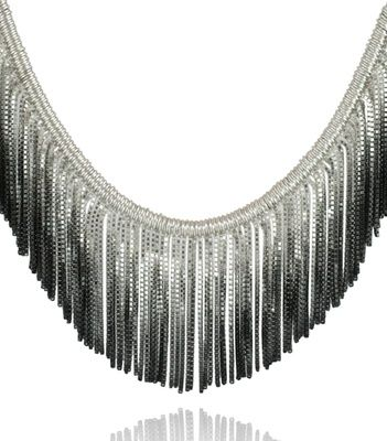 A stunning and unusual contemporary necklace, handmade by jewellery designer Cara Tonkin, this necklace is exclusive to Nude Jewellery.  Made from sterling silver, tassel's of oxidised silver fan out of this necklace reminiscent of the fringing detail of a 1920's flapper style dress.   This is a show stopping item with plenty of movement and volume.  Tassel length 35mm (approx)
