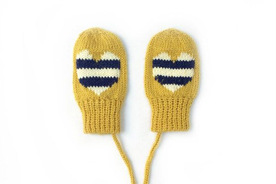 Button and Blue Heart Mittens  Sunshine yellow baby mittens, featuring a stripey nautical heart. These warm and cosy mittens also have a string