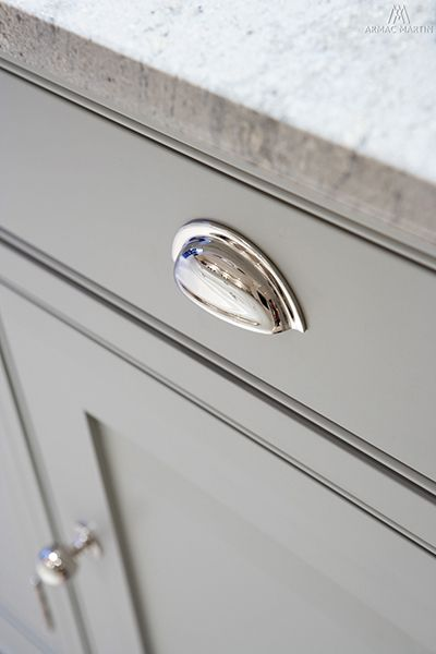 Loving the look of the polished chrome on matte gray cabinets. Great hardware choice for kitchen updates.