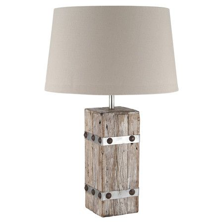 crafted from wood this rustic table lamp features a taupe cotton shade team with a stone fireplace and exposed wood beams for country cabin appeal - Lamp Shades For Table Lamps
