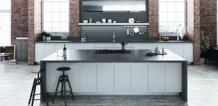A modern industrial kitchen with a benchtop in essastone in bitumen