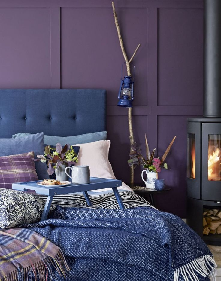 Modern Purple Bedroom with Button-back Headboard and Blue Upholstery