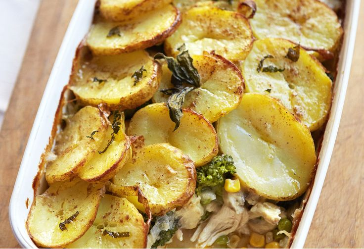 Get the kids in the kitchen to help use up leftover cooked chicken in this hearty pie topped with slices of potato.