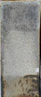 Glazeitorium Nick's Misfire: Neph. Sye. 44.4 Whiting 16.7 Silica 11.1 Kaolin 16.7 Talc 11.1 Copper Carbonate 1.1 Tin oxide 11.2