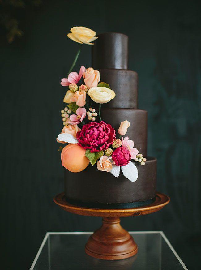 Dark 3-tier wedding cake with sugar flowers