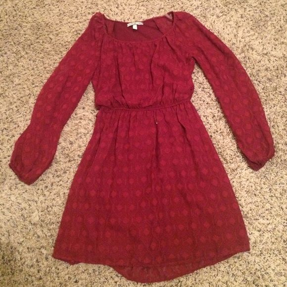 Long sleeve crimson dress Brand new and never worn. Bought this dress at belk and haven't had anywhere to wear it. The sleeves had openings that are really cute (see pics). The dress is fully lined. XS Dresses Long Sleeve