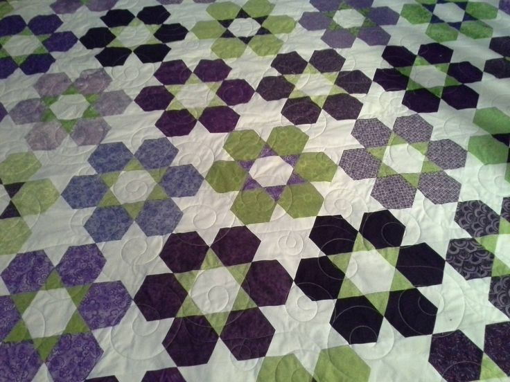 From Friendship Quilt Group, made by Janet Orr with the Hexes 'n More ruler.  Pattern is Hexie Garden by Atkinson Designs