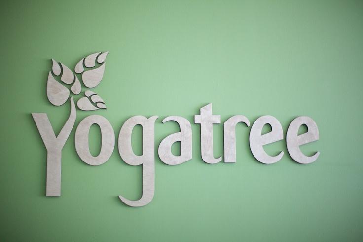 #yogatree wood logo
