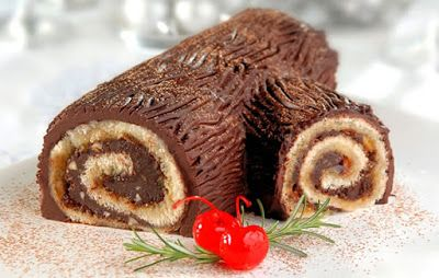Tronco de Navidad from Barcelona. The Christmas Log.  This cake is rolled with chocolate in the shape of a  tree trunk, remeniscent of another Catalan Christmas tradition: 'Caga Tio'. A few days before Christmas, the kids gather around a big log covered by a blanket. The blanket hides gifts for the children. They sing a traditional song while they beat the log with a stick and then discover that the log (tió) has left them presents. The Spanish Touch - private tours in Spain