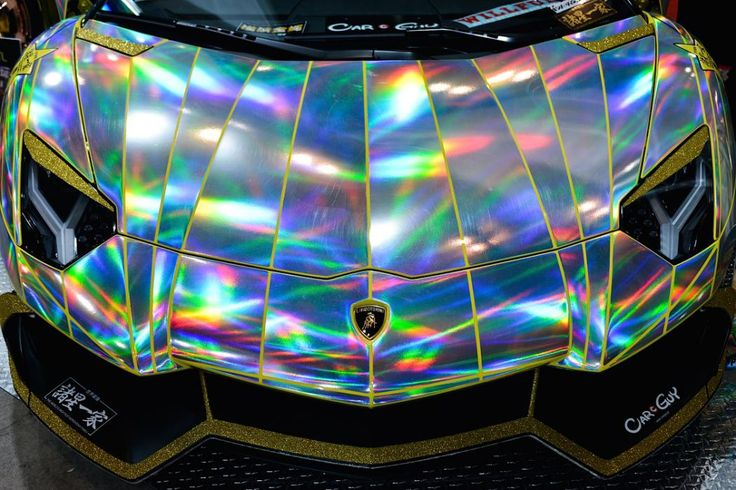 Lamborghini Aventador A close up of a  Lamborghini Aventador wrapped in holographic vinyl.