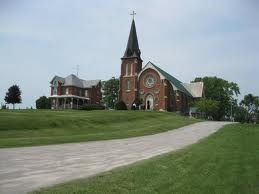 St. Columkille Church, Orillia, Ontario  - founded in 1855; was the first Catholic church in th area  - Father Henry McPhillips died in 1897 but is his apparition is still seen  - the organ is known to play on its own, sometimes accompanied by the spirit of a man seen wearing a top hat in the upper choir area  - near the old rectory is a vault containing 20 bodies; the sealed door is known to open on its own  - very loud music & drum beats are heard coming from the empty church