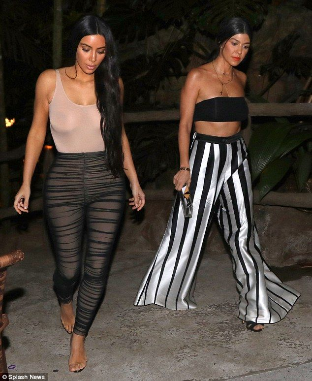 Sheer beauty! Kim Kardashian left little to the imagination in a nude-coloured top when she stepped out for dinner with sister Kourtney in Costa Rica