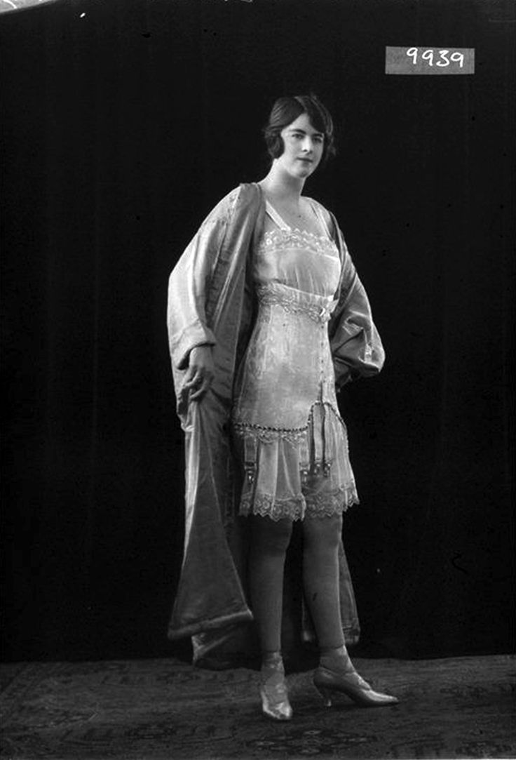 Glass Half Plate Image of a woman modelling a Mercedes corset for the stay and corset maker Miss Byron Corsets. Published in Ladies' Field. Maker: Bassano Studio Production Date: 1922-03-31