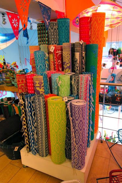 the banig (floor mat) --these colorful ones look like they were made for decorative purposes. The traditional version of this, made from an indigenous species of grass or reed is used for sleeping,  either laid on the floor or on a wooden cot.