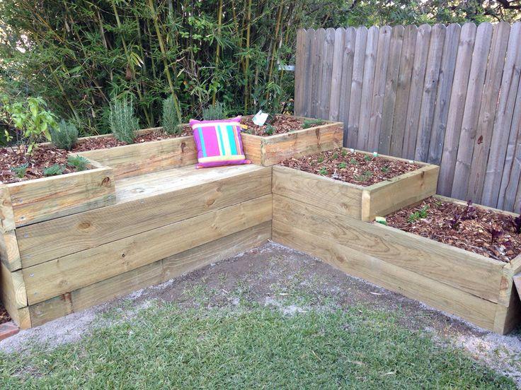 Rasied garden bed. Vegetable and herb garden. Built in seat. DIY sleepers. Bay tree. Flower garden.
