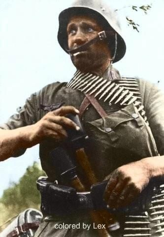 A german machine-gunner looks like loading back up to go out on another mission.