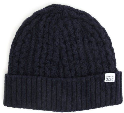 $48, Navy Beanie: Norse Projects Cable Knit Navy Beanie Sale. Sold by Menlook. Click for more info: https://lookastic.com/men/shop_items/191862/redirect