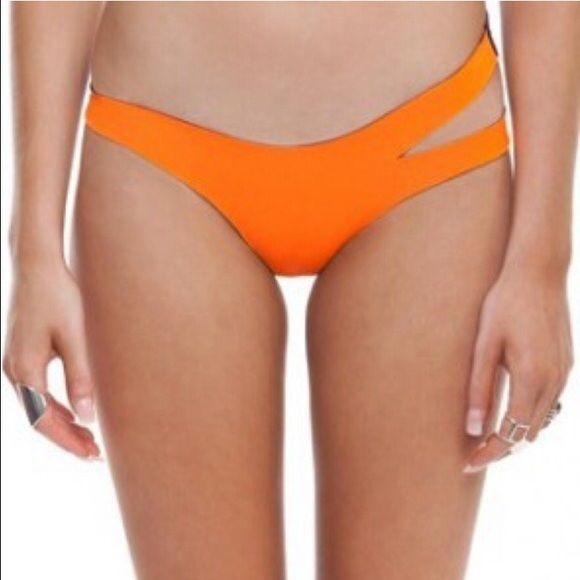 N.L.P Classic Cut Out Bottoms Purple and orange, side cut out. Neoprene material. New with tags. N.L.P Swim