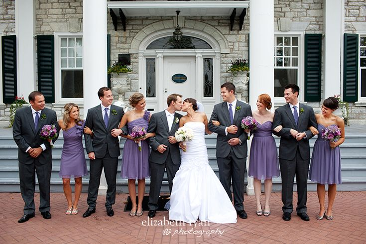 Charcoal gray suits, purple ties...Whole wedding is gorgeous, but couldn't pin it.---esxcept for with the guys having navy blue ties or even yellow