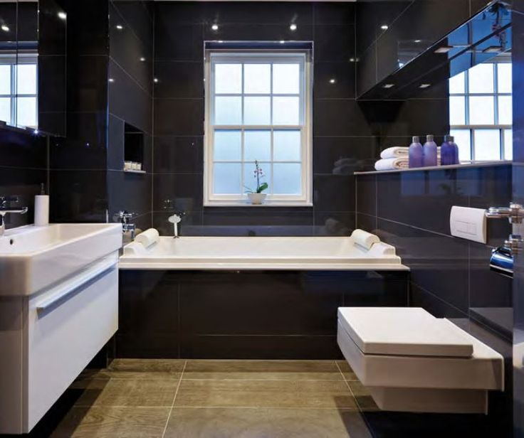 the bathrooms range from beiges and truffle colours through to coffee shades and onto deep black but with the Kensho grey Silestone linking them together.