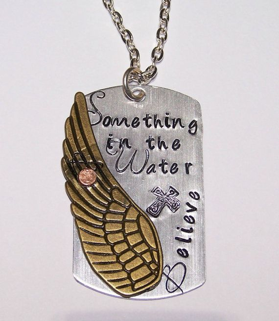 This custom designed metal stamped aluminum dog tag necklace features the hand stamped phrase Something in the Water made popular by the country