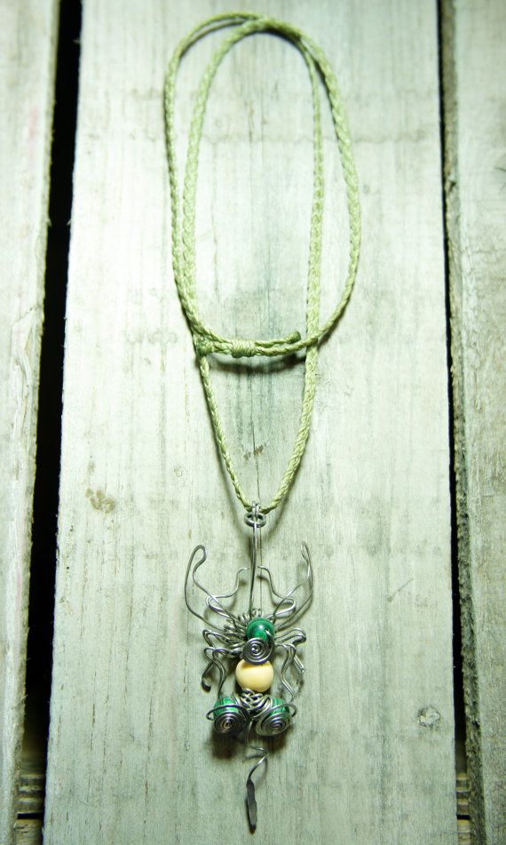wire fly pendant stainless steel, malaquite, açaí seed, soft green macramé chain by raizesimaginarias