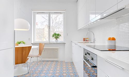 This pic has many of my favourite things - the table, the lamp (I have both but not together though), the clean kitchen (looks a bit like mine), the floor (want it!), the combo of white and wood...