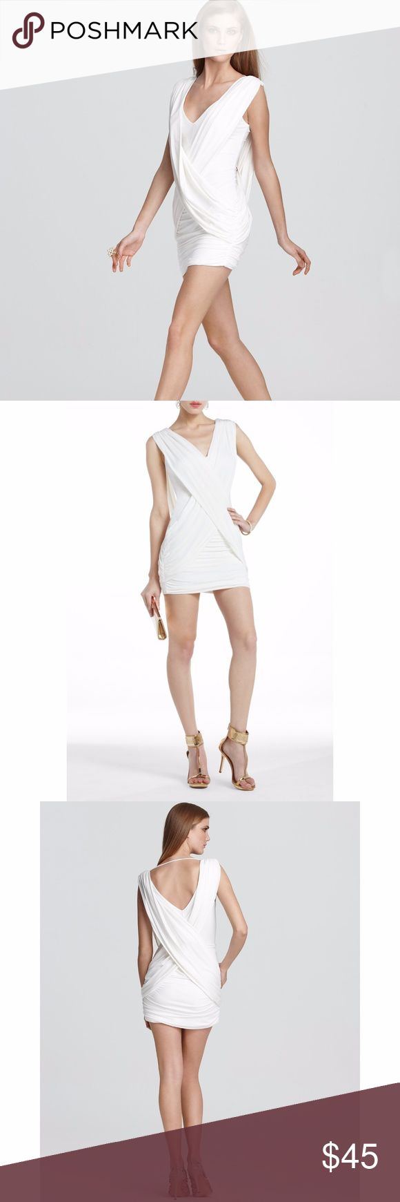 """BCBGMAXAZRIA white alondra dress Worn once. Great homecoming or semiformal / winter formal dress!  Allover ruching and dramatic crossover drapes define this fluid jersey style.  Surplice neckline Sleeveless Crossover front drape Allover ruching Crossover back with spaghetti strap detail About 18"""" from natural waist Acetate/nylon/spandex Dry clean BCBGMaxAzria Dresses"""