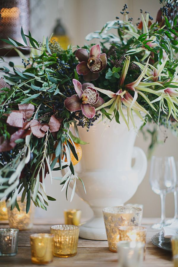 leafy centerpiece, photo by Our Labor of Love by Heidi, styling by Juli Vaughn Designs http://ruffledblog.com/gilded-winter-romance #winterwedding #flowers #centerpieces