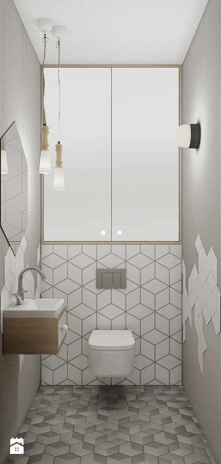 This modern small bathroom has some fantastic on-trend features like geometric tiles, low hanging lighting and a hexagon mirror.