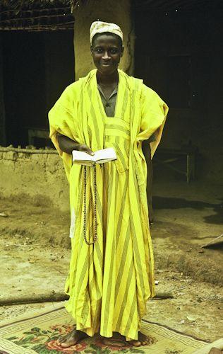 Tumutu Ahmad on his prayer mat. Liberia 1963  www.liberia77.com