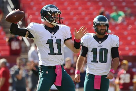 Eagles vs. Redskins:     October 16, 2016   -  27-20, Redskins  -      Oct 16, 2016; Landover, MD, USA; Philadelphia Eagles quarterback Carson Wentz (11) throws the ball as Eagles quarterback Chase Daniel (10) looks on during warm ups prior to the Eagles' game against the Washington Redskins at FedEx Field. Mandatory Credit: Geoff Burke-USA TODAY Sports