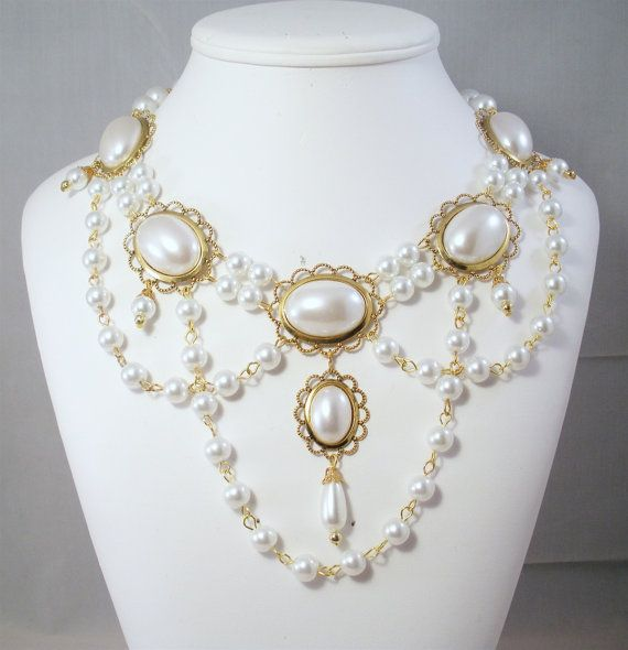 This hand-crafted, professionally made jeweled necklace was created based on the jewelry worn by royalty and the landed gentry of the Medieval and Renaissance Eras. It will add that finishing touch to any noblewomans attire. Made From: Gold Plated or Silver Plated Settings Czech Glass Pearls Gold Plated Findings Acrylic Cabochons Czech Glass Pearl Drop @17 inches with a 3 inch extension I love making jewelry that takes us back in time. I believe in providing my customers with qu...