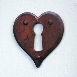 heart shaped rusty keyhole