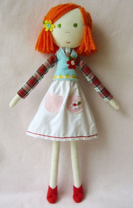 Lovely clothes on the doll and a red head to boot.   http://www.handmadeplease.com/photo_3337415.html